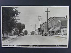 Cecil Wisconsin WI Main Street Visible Gas Pumps Real Photo Postcard RPPC 1944