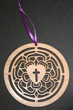 Luther's Rose laser cut wooden ornament. $8.00, via Etsy.