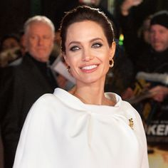 From Runway to the Red Carpet: Angelina Jolie Stuns In Winter White  #InStyle