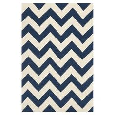 Wool rug with a chevron motif. Hand-tufted in India.   Product: RugConstruction Material: 100% WoolColor: Blue and ivoryFeatures: Hand-tufted in India Note: Please be aware that actual colors may vary from those shown on your screen. Accent rugs may also not show the entire pattern that the corresponding area rugs have.