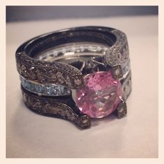 Black gold ring with pink topaz and aquamarine