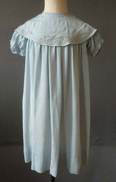 Child's blue silk dress with embroidered collar, by Liberty of London, English, c. 1910.