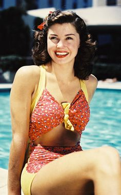 Esther Williams died today. She was discovered swimming alongsideTarzanstarJohnny Weismuller as part ofBilly Roses Aquacade show in San Francisco and her career took off in the 1940s when she starred in a series of aquamusicals, romantic dramedies with lavish sequences of synchronized swimming and diving.