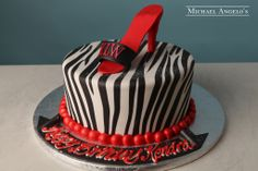 Zebra with Shoe #10AnimalPrint  This classic zebra print cake is iced in fondant and topped with a red high heeled shoe.  The birthday girl's initials are shown on the shoe strap to give an extra personal touch.