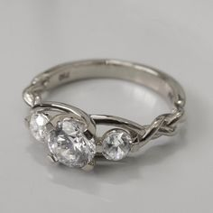 Hey, I found this really awesome Etsy listing at https://www.etsy.com/listing/202053363/braided-platinum-engagement-ring