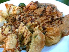 BATAGOR (INDONESIAN FOOD). consist of fried tofu, potatoes, some kind of fried dimsum and pored with peanut spicy sauce