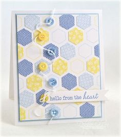 handmade card: Hello From The Heart Card by Debbie Olson for Papertrey Ink (July 2012) ... luv the stamped hexagons in blues, yellow and white ... random, all-over pattern ... sweet detail of matching little button running up and down with a bit of white string between them ... reminds me of a Swedish summer ... great card!!