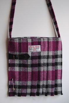 Large pink, grey and black tartan Harris Tweed fashion accessory shoulder bags in the shape of a kilt, handmade on Orkney.