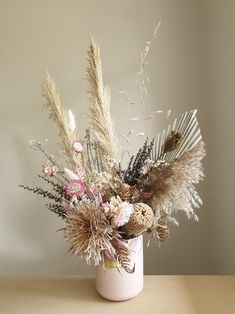 Dried flower arrangement in ceramic pot including Pampas gras, Palm spear, Paper daisies, Protea, Banksia and more dries ingredients. Beautiful as your home or event decor Rustic Flower Arrangements, Rustic Flowers, Balloon Flowers, Hanging Flowers, Dried Flower Bouquet, Dried Flowers, Australian Native Flowers, Flower Bar, Jars