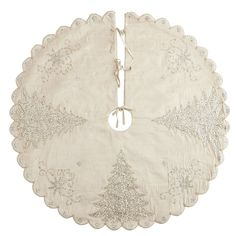 A vision in white and gold, our tree skirt sparkles with bead-embellished embroidery. Elaborate Christmas trees, exquisitely scrolled designs and a pretty scalloped hem create a footnote for your tree that twinkles and shines. Like so many elegant finds at Pier 1, this one is exclusively ours. Z