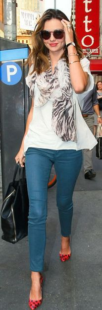 Miranda Kerr wearing a Mulberry Tiger Print Scarf. Follow this trend with one of our wild animal print scarves.