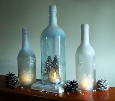 handmade wine bottles that have been frosted and painted, cut and sanded to be transformed into hurricane candle holders ~ by MagicOwlDesigns