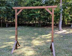 Medium brown stained wood.  8' high x 8' wide.  Double cross beams at top.  Easy to assemble/disassemble.  Available for rental for weddings and events in Charlotte, NC.
