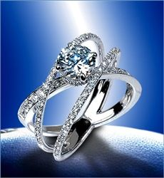 """3 crossing wedding bands. Ecc. 4:12 states """"a cord of 3 strands is not quickly broken"""" God, Husband and wife."""