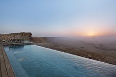 Beresheet Hotel in Israel stands on top of a cliff overlooking the Ramon Crater, a beautiful almost Martian-like landscape.