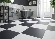 A black and white floor adds elegance to any room. Use Quebec, with its hint of quartz-like sparkle, in a checkerboard or diamond format to create a standout hallway or bathroom floor. Bathroom Flooring, Clawfoot Bathtub, Black And White, Interior, Quebec, Bathrooms, Quartz, Diamond, Create