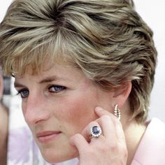 prince charles before diana | an 18-carat oval blue sapphire surrounded by 14 brilliant-cut diamonds ...
