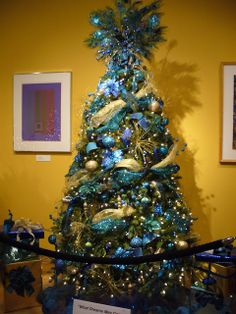 the sparkle queen festival of trees 2012 peacock themed tree with teal blue - Teal And Gold Christmas Decorations
