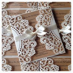 Cream lace doily Lasercut wedding invitation with Kraft card insert, double satin ribbon now By Epiphany Designs NI