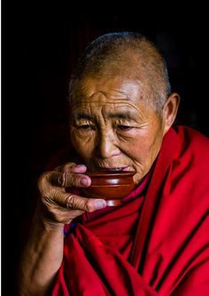 nun drinking butter yack tea in a monastery - Tibet by Blaine Harrington
