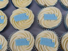 'Thank you' cupcakes - vanilla sponge topped with a butercream swirl and a fondant 'thank you' tag.