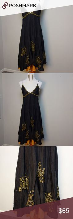 Anthropologie Chan Lulu Boho Dress Black and gold layers of soft silk. Delicate straps that tie in the back. Chunky crochet vibe embroidery on bodice with larger gold and black flowed scattered across bottom of dress. Asymmetrical hem line. Dress falls softly from bodice in soft drapes of silk. Dress it up for summer nights or go casual with sandals and your favorite necklace. This dress is perfection. EUC. Dry cleaned. Worn twice. Stored in dress bag. No fabric or care tag so I suggest dry…