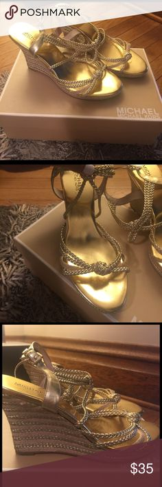 Michael Kors Summer Wedge Gold metallic in color. Worn a few times. In great condition. I do have the box but may be easier to ship without it. If you prefer the box, let me know. Michael Kors Shoes Wedges
