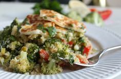 Warm quinoa salad stuffed with veggies, served with grilled halloumi and drizzled with a simple lemon and parsley dressing.