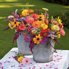 Backyard Blooms | These cheery blooms are easy to grow, require minimal care once established, and yield plenty of flowers for cutting. For quick arranging into a casual bouquet, like the one shown here, place large sunflowers in container first. Then add cockscombs, a great filler that provides texture. Tuck in as many zinnia blooms as possible and finish with small gomphrenas flowers to accent.