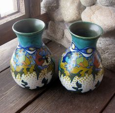 Pair of Gouda Art Pottery Vases, Circa 1921, $325. Available at riverhouseartpottery.com.