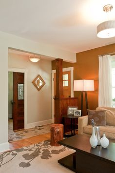 add a pony wall to create the illusion of an entryway in a house where the front door opens right into your living room