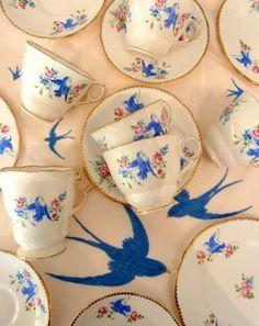 A vintage bluebird tea set & hand embroidered vintage table cloth.