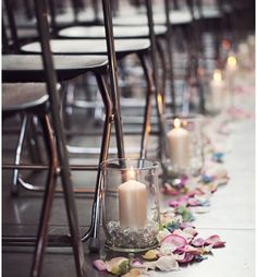 Like this candle and petals aisle decor but not sure it would work for an outdoor ceremony