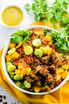 Jamaican Jerk Tempeh Mango Bowl. A light, spice and flavor filled dish that has the perfect balance of sweet, tangy and spicy.