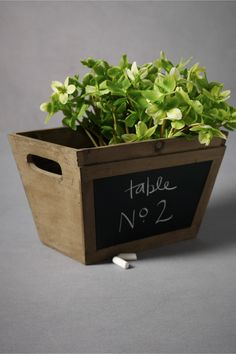 Wood crate with chalkboard front.