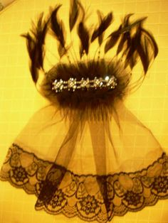 Feathered hair comb with black netting and lace, runched black netting surmounted by gray bead work
