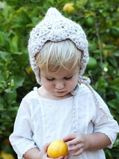A soft and cozy pixie baby bonnet for your boho baby girl! Hand made bonnet in a crochet shell stitch to add femininity and texture. It has a scalloped edge across the forehead. Baby Bonnet Pattern, Baby Cocoon Pattern, Crochet Baby Bonnet, Crochet Baby Cocoon, Crochet Hats, Crochet Outfits, Baby Patterns, Crochet Patterns, Crochet Shell Stitch