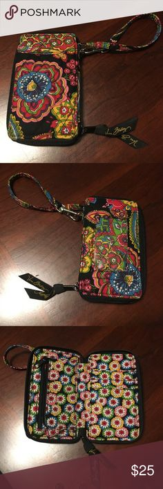 "Vera Bradley symphony in hue. carry all wristlet. Vera Bradley symphony in hue, carry all wristlet. Zip closure, window ID on front w/slip window and slip pocket on other side. Small zip pocket on inside, slots for cards and pocket for cash. 5"" x 3"". About 1 inch thick. Super cute and in excellent condition. Vera Bradley Bags Clutches & Wristlets"