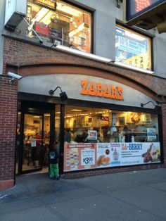 Zabar's:  Quintessential NYC jewish grocery store, deli, and bakery.  Featured in numerous movies, and a local favorite.