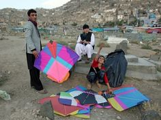 Afghan boys prepare their kites during a kite flying competetion in Kabul, Afghanistan