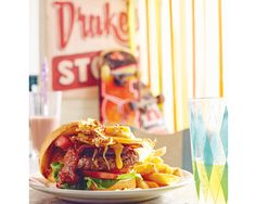 Jane Lawson shares fond childhood milkbar memories with us and shows us how to make one of those good 'ol beef burgers with 'the lot'. The milkbar had everything a child could wish for. We di… Burger And Chips, Aussie Food, Beef Burgers, Good Ol, What To Cook, Allrecipes, Food To Make, Hamburger, Treats
