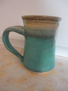 Pottery mug in turquoise and eggshell by NancyBloklandPottery, $22.00