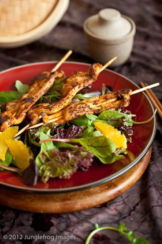Marinated chicken on a stick and living leaner