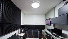 O quarto essencialmente masculino, com predomínio das cores neutras e linhas retas.