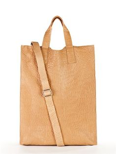 Pure NS Tote - DKNY  I LOVE this bag! They are so flattering to wear-  gives the wearer a long, leaul.n look. The leather is beutiful