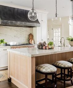 Great kitchen design with wood and marble | Katie Rosenfeld