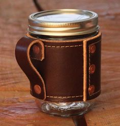 Holdster Mason Jar Sleeves, made in Vermont. Mason jars are the go-to to-go cup for hipsters and the eco-friendly alike. Upgrade your mug and protect your hand from your hot or cold bevvie with Holdster's line of leather sleeves ($21.99 and up).
