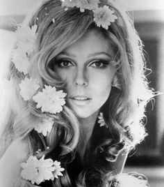 Nancy Sinatra with flower hair...would looks so dreamy, bohemian, and ethereal on a bride.