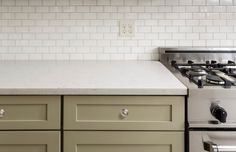 Photo about Kitchen Counter with Subway Tile, Stainless Steel oven stove, Shaker Cabinets. Image of area, countertop, outlet - 40052384 Dirty Kitchen, New Kitchen, Kitchen Decor, Kitchen Ideas, Kitchen Cabinet Colors, Kitchen Cabinets, Armoires Shaker, Hotte Design, Layout Design