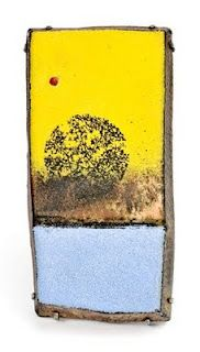 Jamie Bennett, composes his very detailed jewelry using paint, pencil, and enamel